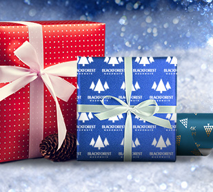 holiday gifts wrapped with personalized gift wrapping paper